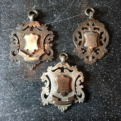 Antique silver sports medals/fobs
