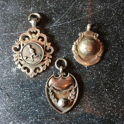 Antique silver football sport medals/fobs