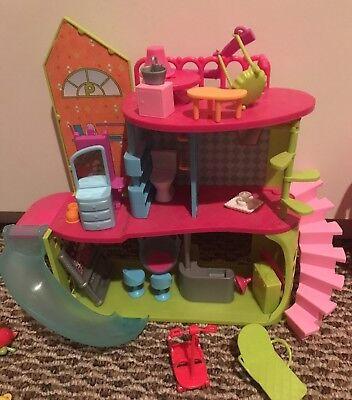 Polly Pocket-lot of 2 dolls, 2 play houses, and assorted accessories