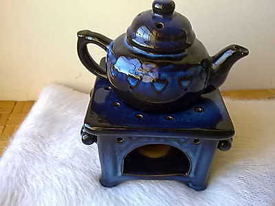 Pottery Teapot and warmer stand