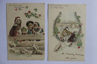 Two early postcard Christmas cards, 1902, children with pigs