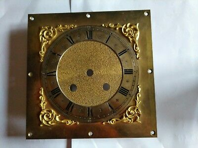 Long case clock brass clock face