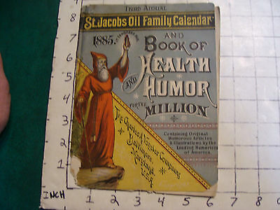 1885 St Jacobs OIL Family Calendar & book of HEALTH and HUMOR red wizzard cover