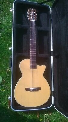 Crafter CT125 solid body nylon string electric guitar with hard case.