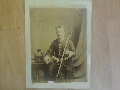 Vintage photograph of soldier with gun