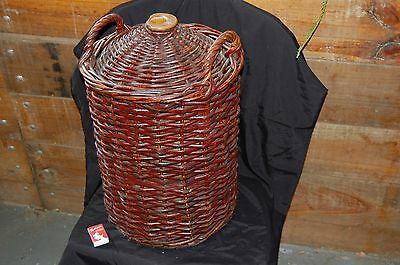 Rare original Australian Bendigo Pottery wine ewer with basket weave covering.