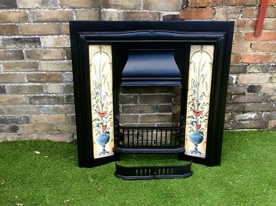 Cast iron Victorian/Edwardian fireplace surround with tiled inserts.