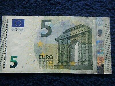 €5 euros. Left-Over Holiday Money