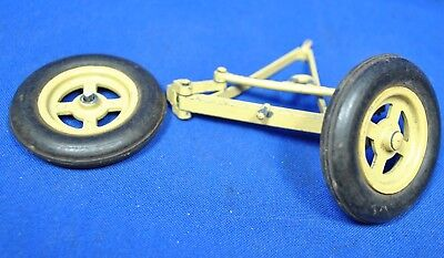A pair of Matchbox Lesney Massey Harris Tractor front wheels tyres and axle