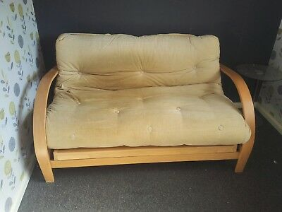 Futon, beige corduroy upholstery, wood frame, nice condition, makes double bed.