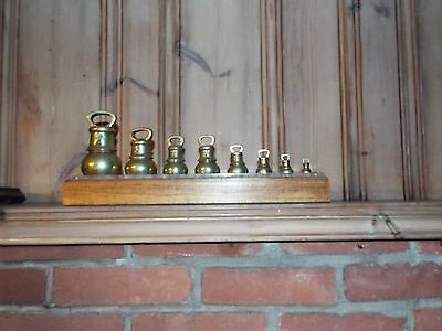 Set of 8 graduated Brass weights