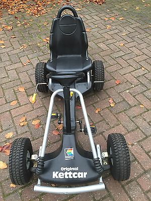 Kettler Kettcar nitro X-treme pedal go-kart in black with yellow features.