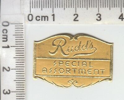 """Rudd's SPECIAL ASSORTMENT"" Tannish Orange on Embossed, Die Cut GOLD FOIL Label"