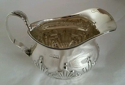 A Victorian sterling silver cream jug. London 1899.By William Hutton & Sons Ltd