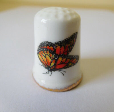 Red butterfly, bone china thimble, Fenton