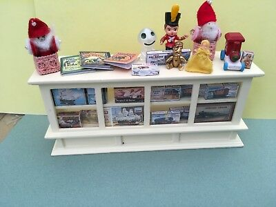Dolls house cream shop counter with toys and games