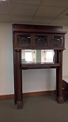 Antique Tiger stripe Oak Mantel with mirror and leaded glass display nooks