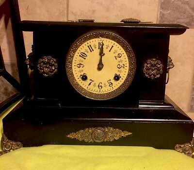 New Haven Cast Iron Black Mantle Clock, Guilded Ornaments, W/ Wolf Heads Antique