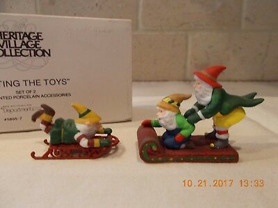 "Dept. 56  Heritage Village Collection -"" Testing The Toys "" -Set of 2 - #5605-7"