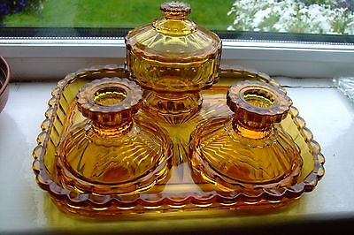 Amber brown pressed glass dressing table set.