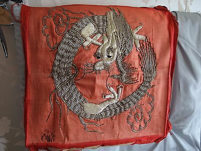antique Chinese hand embroidery of a dragon on silk