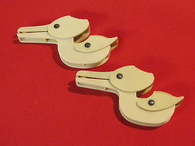 Pair of vintage 1940s celluloid stork baby crib blanket or sheet bedding clips