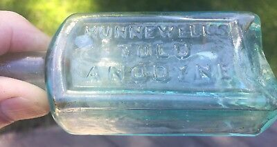 "Hunnewell's Tolu Anodyne/Boston Mass, 4"" aqua medicine bottle, pontil"