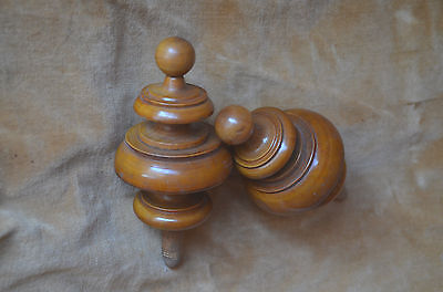 Pair of antique hand turned wooden finials, light wood