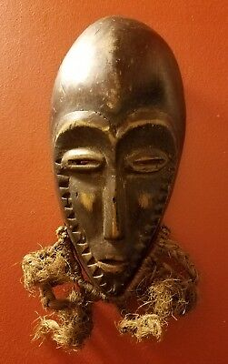 Small vintage African carved wood mask w/ raffia wall art sculpture decor