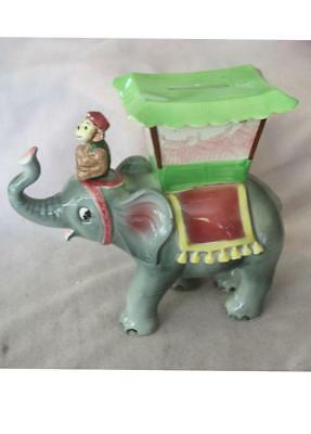 Vintage Circus Elephant with Trunk Up and Monkey Riding on Head Bank
