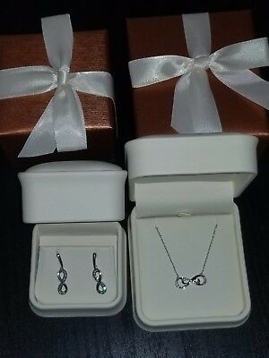 Diamond Infinity Necklace and Earrings. 14k White Gold.