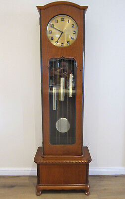 Junghans Queen Anne styled grandfather clock in Figured Blackwood