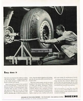 1943 Boeing Aircraft WW2 Worker Installing Wheel on Flying Fortress Vtg Print Ad