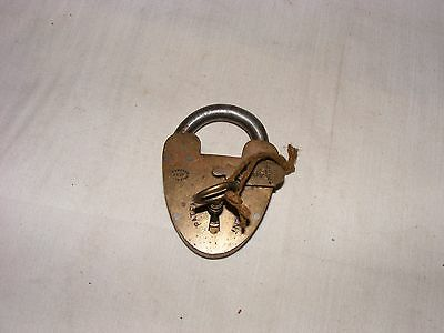 A scare beautiful brass iron British pad lock with original key smoothly working