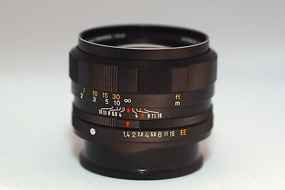 MINT Konica Hexanon AR 57mm f1.4 with caps beautiful lens
