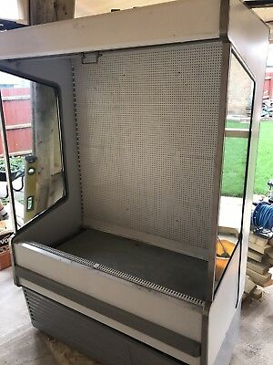 Used Commercial Refrigerator, White In Colour And Works Very Well