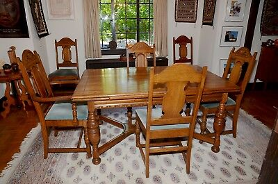 Antique oak table and six chairs, with table pads