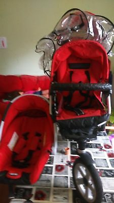 "Double 'JANE"" buggy with rain cover and one car seat"