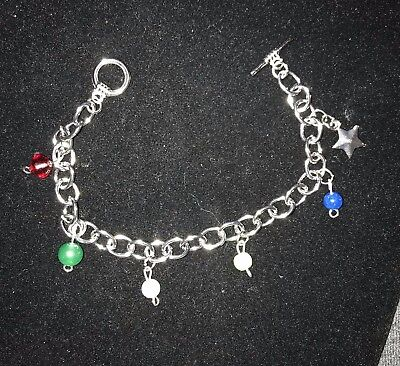 BEAUTIFUL OES Silver Charm Bracelet with star charm for all those Sistars