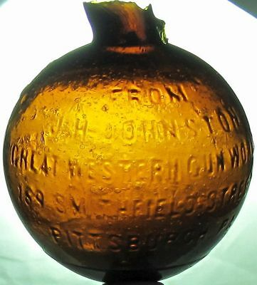 J.H. Johnston amber glass Pittsburgh, PA target ball. rare!