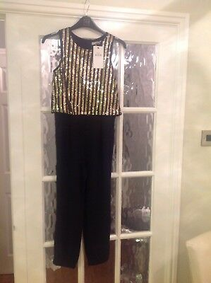 Girls gorgeous Black and gold M&S jumpsuit age 9-10