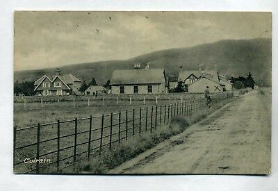 CULRAIN   Village road with houses and person sitting on a fence  RP