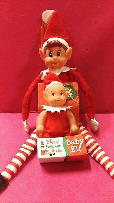 Santas elf on the shelf with elf baby