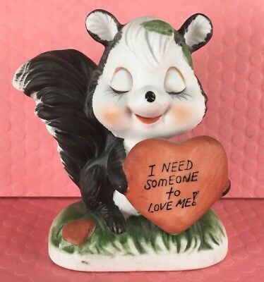 Skunk on Grass Holding Heart Need Someone To Love Me and Heart Ceramic Vintage