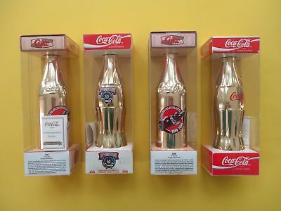 4 Gold Commemerative COCA-COLA BOTTLES  1900 Crown Top, NASCAR, 100 Years