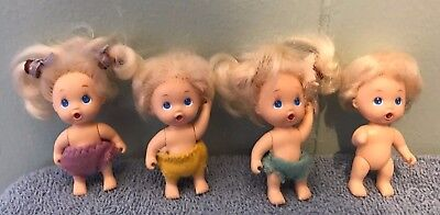 "Vintage 1990 TYCO 4 of Baby Quints Drink and Wet 2.5"" mini Babies dolls"