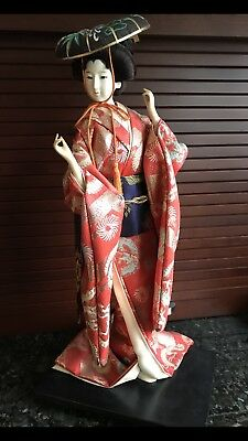 Vintage Japanese Geisha girl doll figurine on wooden base