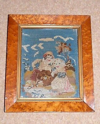 Georgian C19th  Woolwork of a boy and girl in a Georgian birds eye maple frame
