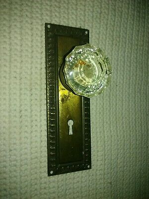 old door plate with glass knob mounted on it for crafting hook