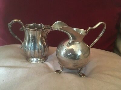 Two Antique/Old Silver Plated Cream Jugs Of Contrasting Ornate Form & Decoration
